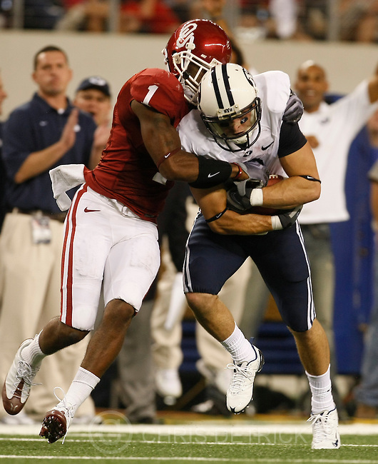 Brigham Young's McKay Jacobson #6 is tackled by Oklahoma's Dominique Franks #1 during the first half of the game against Oklahoma at Cowboys Stadium Saturday September 5, 2009. Oklahoma is winning 10-7...Photo by Chris Detrick/The Salt Lake Tribune