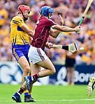 Peter Duggan of Clare goals despite Daithi Burke of Galway during their All-Ireland semi-final replay at Semple Stadium,Thurles. Photograph by John Kelly.