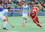 The Hague, Netherlands, June 15: Nick Catlin #26 of England in action during the field hockey bronze match (Men) between Argentina and England on June 15, 2014 during the World Cup 2014 at Kyocera Stadium in The Hague, Netherlands. Final score 2-0 (0-0)  (Photo by Dirk Markgraf / www.265-images.com) *** Local caption *** (L-R) Pedro Ibarra #5 of Argentina, Matias Rey #22 of Argentina, Nick Catlin #26 of England