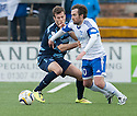 Peterhead's Jamie Stevenson tries to get away from Forfar's Danny Denholm.
