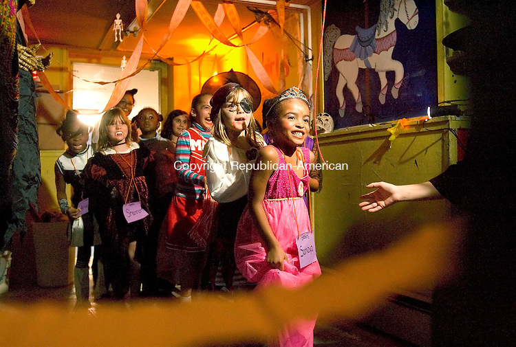 WATERBURY, CT-- 26 OCTOBER 2007--102607JS19-Young girls make their way through the haunted hallway on Friday as part of Girls Inc.'s Spootacular Boo Bash held at their building in Waterbury. <br /> Jim Shannon / Republican-American