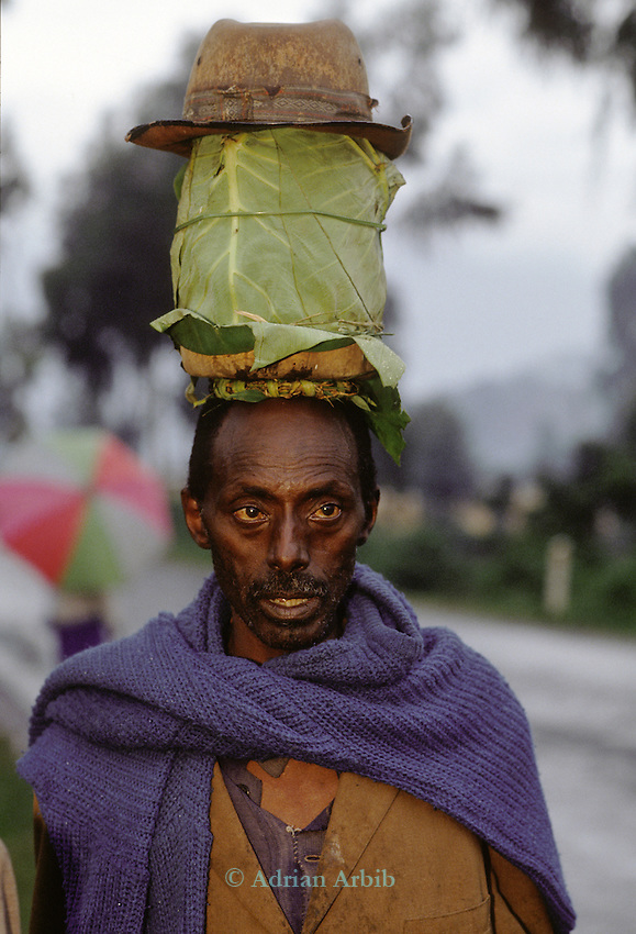 Tutsi man carrying milk on his head . Lake Kivu, Western Rwanda.