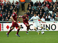 Pictured: Swansea's Ben Davies clears the ball as Jonas Guitterrez gives chase<br />