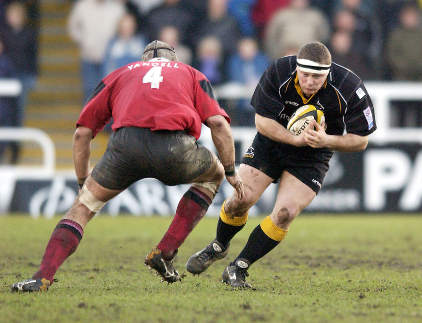 Photo. Jed Wee.Newcastle Falcons v Saracens, Parker Pen Challenge Cup, Kingston Park, Newcastle. 19/01/2003..Newcastle's Micky Ward (R) is faced by Saracens' Craig Yandell.