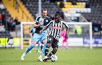 Stanley Aborah of Notts County turns Paul Hayes of Wycombe Wanderers during the Sky Bet League 2 match between Notts County and Wycombe Wanderers at Meadow Lane, Nottingham, England on 28 March 2016. Photo by Andy Rowland.
