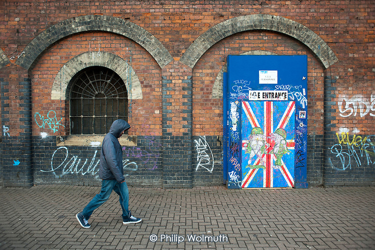 Shoreditch, London, a run-down commercial district  also known as Silicon Roundabout, which is undergoing gentrification as it becomes a centre for web-based companies and IT start-ups.