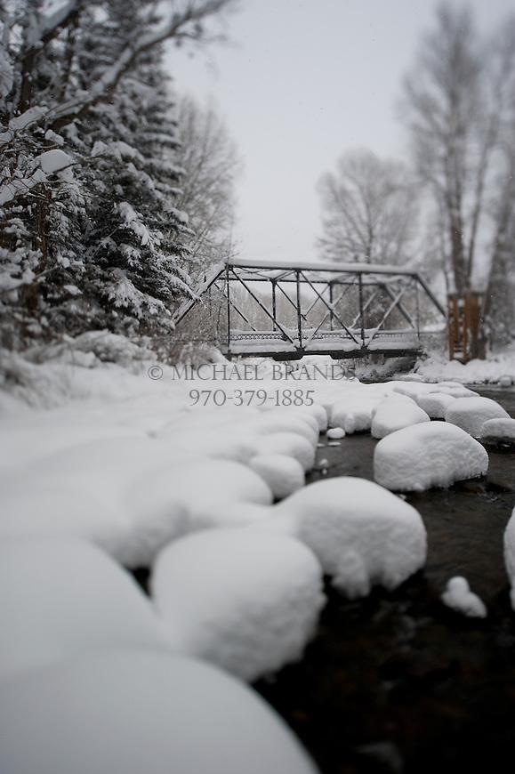 Pedestrain bridge over the Roaring Fork River in Aspen, Colorado.