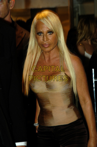 DONNATELLA VERSACE.The aftershow dinner and party celebrating the refurbishment of the Versace London store at Locanda Locatelli, Sloane Street..September 19th 2005 .London, United Kingdom.Ref:Ian Allis.half length gold skin coloured fitted corset bodice eye contact posed.www.capitalpictures.com.sales@capitalpictures.com.©Capital Pictures