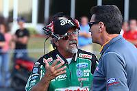 May 16, 2014; Commerce, GA, USA; NHRA funny car crew member John Medlen (left) talks with Bob Tasca II during qualifying for the Southern Nationals at Atlanta Dragway. Mandatory Credit: Mark J. Rebilas-USA TODAY Sports