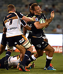 Sharks player Andre Esterhuizen (R) is tackled by Brumbies players during the Super Rugby match between the ACT Brumbies and the South African Sharks in Canberra on March 17, 2018. AFP PHOTO / MARK GRAHAM --- IMAGE RESTRICTED TO EDITORIAL USE - STRICTLY NO COMMERCIAL USE --