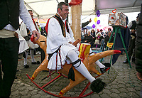 Pictured: A man in traditional Greek costume rides a penis-shaped see-saw in Tirnavos, central Greece. 19 February 2018<br /> Re: Bourani (or Burani) the infamous annual carnival which dates to 1898 which takes place on the day of (Clean Monday), the first days of Lent in Tirnavos, central Greece, in which men hold phallus shaped objects as scepters in their hands.