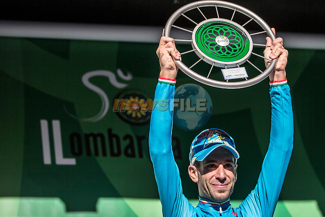 Italian National Champion Vincenzo Nibali (ITA) Astana celebrates on the podium after taking victory at the end of Il Lombardia 2015 running 245km from Bergamo to Como, Italy. 4th October 2015.<br /> Picture: ANSA/Angelo Carconi | Newsfile
