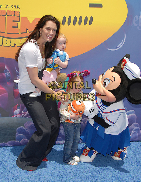 BROOKE SHIELDS & DAUGHTERS.attends The Finding Nemo Submarine Voyage Celebrity Preview held in Tomorrowland at Disneyland in Anaheim, California, USA, June 10 2007                                                                     full length baby girls family kids toy fish Minnie Mouse cartoon disney characters.CAP/DVS.©Debbie VanStory/Capital Pictures