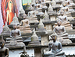 Buddha statues at Gangaramaya Buddhist Temple, Colombo, Sri Lanka, Asia