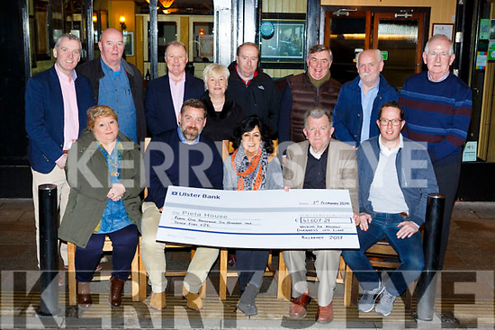 Marie O'Carroll presents the proceeds of  Walking for Nathan Darkness into Light to  Pieta House in the Porterhouse restaurant on Thursday night front row l-r: Maureen McCormick, Brian Higgin Pieta House, Marie O'Carrll, Mike Marshall, Martin Driver. Back row: Kieran O'Brien, Gary McCormick, Con O'Connor, Barry O'Rourke, Noreen Marshall, Ciaran Brady, Denis O'Connor and Cathal Walshe