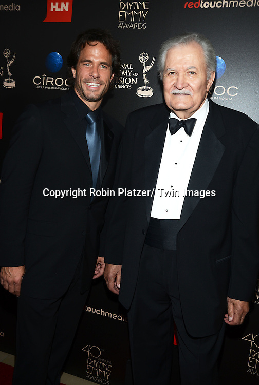 Sean Christian and John Aniston  attends The 40th Annual Daytime Emmy Awards on<br />  June 16, 2013 at the Beverly Hilton Hotel in Beverly Hills, California.