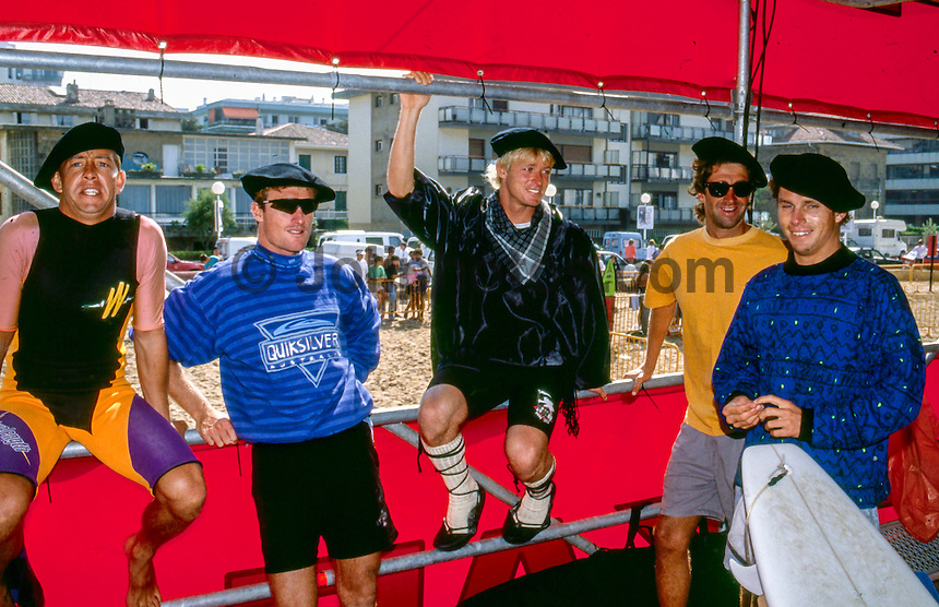 1990, Robbie Bain (AUS), Dave Macaulay (AUS),  Cheyne Horan (AUS), Barton Lynch (AUS) and Damien Hardman (AUS) getting ready for a tag team match up during the running of a Pukas Pro Surf Contest in the village of Zarautz in the Basque Country of Spain,