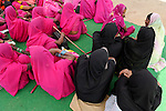 INDIA, Uttar Pradesh, town Banda, low caste and casteless women organize in women movement Gulabi Gang which is led by Sampat Pal Devi, they wear pink saris and carry bamboo sticks called lathi and  fight for equal rights and against violent police or men, MORE PICTURES ON THIS SUBJECT AVAILABLE!!