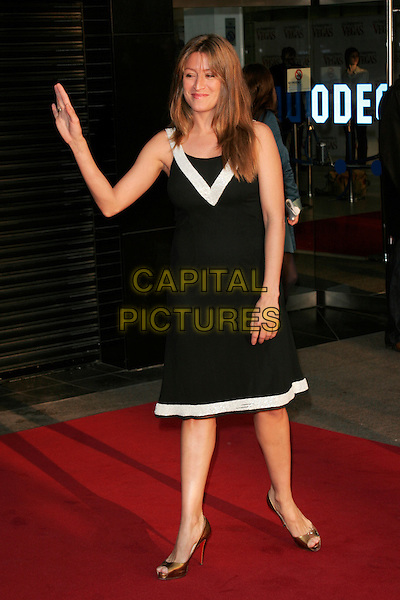 "REBECCA LOOS .World premiere of ""What Happens In Vegas"" held at the Odeon Leicester Square, London, England. .April 22nd 2008 .full length black white trim dress hand waving .CAP/AH.©Adam Houghton/Capital Pictures."