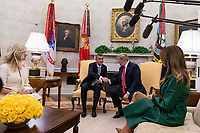 United States President Donald J. Trump shakes hands with the Prime Minister of the Czech Republic Andrej Babis as First Lady Melania Trump and President Trump meet with Babis and his wife Monika Babisova in the Oval Office of the White House in Washington, D.C. on March 7, 2019. <br />   <br /> CAP/MPI/CNP/AE<br /> &copy;AE/CNP/MPI/Capital Pictures