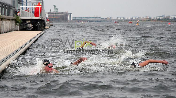 PICTURE BY VAUGHN RIDLEY/SWPIX.COM -  Swimming - Festival of Open Water Swimming - London Regatta Centre, Royal Albert Docks - London, England - 24-25/06/06...? Simon Wilkinson - 07811 267706...Steffanie Biller (L), Esther Nunez (C) and Angela Maurer (R) race toward the finish line in the FINA 10km World Cup Race.