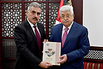 Palestinian President Mahmoud Abbas receives annual report of the military training commission at his headquarters on March 2, 2018 in the West Bank city of Ramallah. Photo by Osama Falah