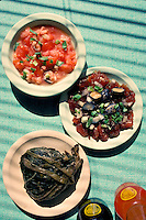 Hawaiian luau food: lomi salmon, poke and lau lau