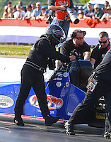 May 16, 2014; Commerce, GA, USA; Crew members help NHRA top fuel dragster driver Ike Meir during qualifying for the Southern Nationals at Atlanta Dragway. Mandatory Credit: Mark J. Rebilas-USA TODAY Sports