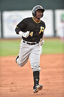 Bristol Pirates designated hitter Maximo Rivera #14 rounds the bases after hitting a home run during a game against the Johnson City Cardinals at Howard Johnson Field July 20, 2014 in Johnson City, Tennessee. The Pirates defeated the Cardinals 4-3. (Tony Farlow/Four Seam Images)