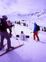 Whistler Ski Resort, BC, British Columbia, Canada - Friends downhill skiing and snowboarding on Whistler Mountain, Coast Mountains