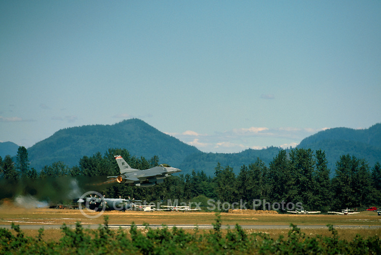 US Air Force General Dynamics F-16 Fighting Falcon (aka Viper) taking off from Runway - at Abbotsford International Airshow, BC, British Columbia, Canada