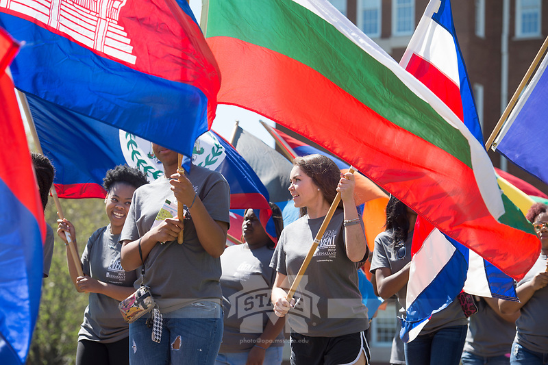 International Fiesta 2017 - Drill Field festival - parade of flags, Big Event volunteers.<br />