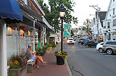 Evening and the main street in Vineyard Haven on Martha's Vineyard Saturday, August 10, 2013. The relaxed atmosphere of the scenic island is a draw for the rich and famous. President Obama and the First Family are vacationing here Aug. 10 - 18th. <br /> Credit: Vince DeWitt / Pool via CNP