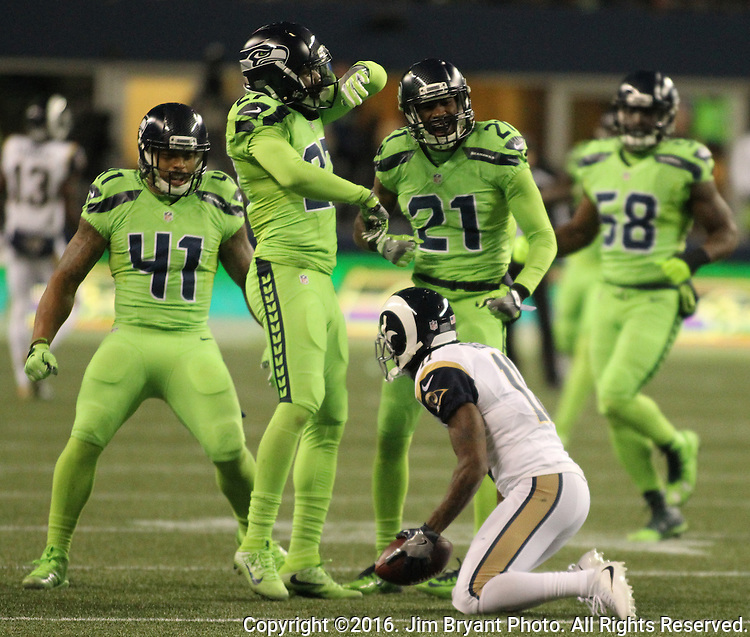 Seattle Seahawks defensive back Neiko Thorpe (27) celebrates a tackle with  linebacker Dewey McDonald (41) and  cornerback DeAndre Elliott (21)  Los Angeles Rams wide receiver Tavon Austin (11) for a no gain that turned the ball over on downs at CenturyLink Field in Seattle, Washington on December 15, 2016.  The Seahawks beat the Rams 24-3.  ©2016. Jim Bryant Photo. All Rights Reserved
