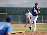 Former Wildcat Justin Garcia makes a throw to first base while pitching in the alumni game at Western Nevada College in Carson City, Nev., on Saturday, Sept. 7, 2013.  <br /> Photo by Cathleen Allison