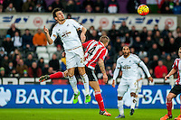 Jack Cork of Swansea City  jumps for the ball during the Barclays Premier League match between Swansea City and Southampton  played at the Liberty Stadium, Swansea  on February 13th 2016