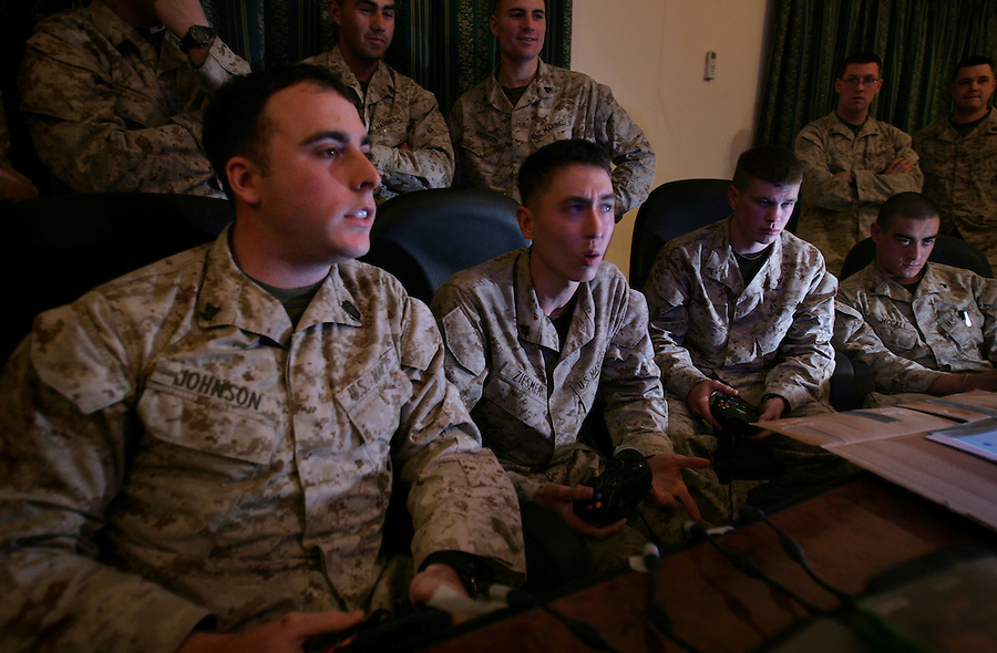 During the calm before what many expected to be the coming storm of the Iraqi elections, Marines and sailors with 2nd Battalion 5th Marines substitute a little simulated violence for the real thing playing against each other in a battalion first-person-shooter video game tournament on January 8, 2005 in Ramadi, Iraq.