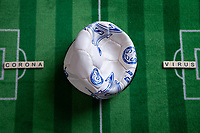 13th March 2020; Germany;  A deflated football with the words corona virus on a football background