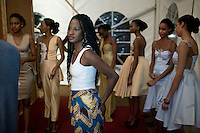 HARARE, ZIMBABWE - SEPTEMBER 26: The designer Rumbie by Rumbie waits with models wait backstage before a fashion show on September 26, 2014 at the Harare City library in Harare, Zimbabwe. Local and African and based designers showed their collections during the 5th edition of Zimbabwe Fashion week (Photo by: Per-Anders Pettersson)
