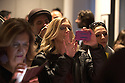 Fans of Andy Summers, former guitar player of the Police, writer and photographer, take pictures with  smartphone of their idol at Leica Gallery where there is an exhibition of his photographs in Milan, March 22, 2016. &copy; Carlo Cerchioli<br />