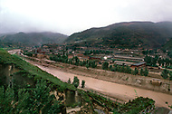 September, 1985. Shaanxi Province, China. The town of Wuqi on the Luo River, one of the poorest in China. Fifty years ago Wuqi was a village with only 7 families, and has grown into a town of 4000 people with shops, schools and electric light.