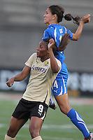 Kandace Wilson (9) and Stephanie Cox (14) jockey for position on a header.