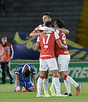 BOGOTÁ -COLOMBIA, 31-08-2014. Jugadores de Independiente Santa Fe celebran la victoria ante Millonarios durante partido por la fecha 7 de la Liga Postobón II 2014 jugado en el estadio Nemesio Camacho el Campín de la ciudad de Bogotá./ Players of Independiente Santa Fe celebrate the victory over Millonarios during the match for the 7th date of the Postobon League II 2014 played at Nemesio Camacho El Campin stadium in Bogotá city. Photo: VizzorImage/ Gabriel Aponte / Staff