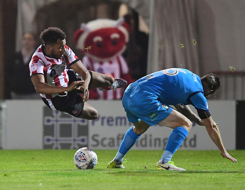 Lincoln City's Matt Green is tackled by Barnet's Michael Nelson<br /> <br /> Photographer Andrew Vaughan/CameraSport<br /> <br /> The EFL Sky Bet League Two - Tuesday 26th September 2017 - Lincoln City v Barnet - Sincil Bank - Lincoln<br /> <br /> World Copyright &copy; 2017 CameraSport. All rights reserved. 43 Linden Ave. Countesthorpe. Leicester. England. LE8 5PG - Tel: +44 (0) 116 277 4147 - admin@camerasport.com - www.camerasport.com