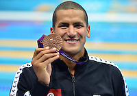 August 04, 2012..Oussama Mellouli pose with the Men's 1500m Freestyle Bronze Medal at the Aquatics Center on day eight of 2012 Olympic Games in London, United Kingdom.