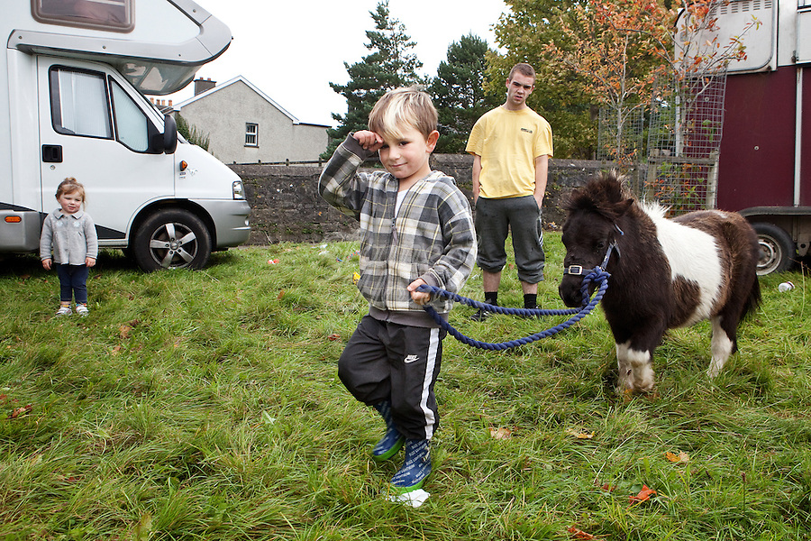 4/10/2010. A traveler boy  plays with his pony near the camp site at the Ballinasloe Horse Fair, Ballinasloe, Ireland. Picture James Horan