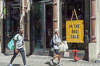 """An Urban Outfitters retail store in the Soho neighborhood of New York advertises it's """"in the Bag Sale"""" on Saturday, June 24, 2017. The retailer also owns the Free People and Anthropologie brands.  (© Richard B. Levine)"""