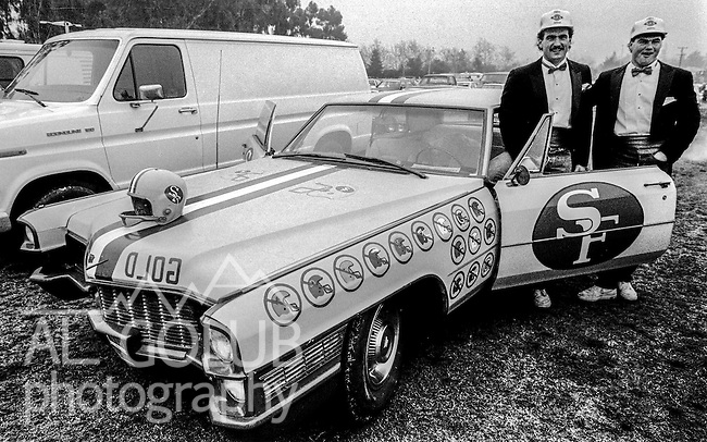 Two 49ers fans decorate their car for the game at the Super Bowl XIX tailgate on the Stanford University campus. The San Francisco 49ers defeated the Miami Dolphins 38-16 on Sunday, January 20, 1985.