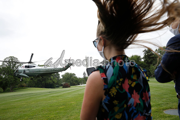 Onlookers watch as Marine One with United States President Donald J. Trump aboard, departs from the White House in Washington, DC en route to Detroit, Michigan on May 21, 2020. Trump is going to participate in a listening session with African-American leaders and tour Ford Rawsonville Components Plant in Ypsilanti, Michigan. <br /> Credit: Yuri Gripas / Pool via CNP/AdMedia