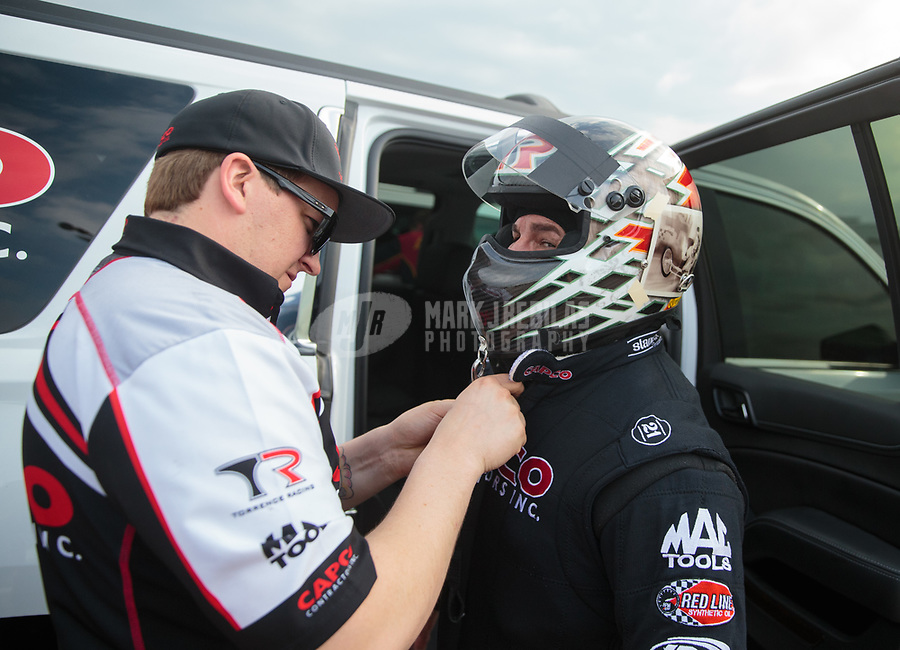 Apr 12, 2019; Baytown, TX, USA; Crew members for NHRA top fuel driver Billy Torrence during qualifying for the Springnationals at Houston Raceway Park. Mandatory Credit: Mark J. Rebilas-USA TODAY Sports